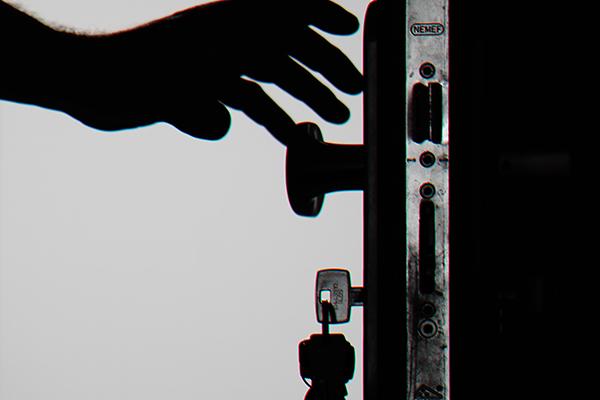 Person unlocking their uPVC front door