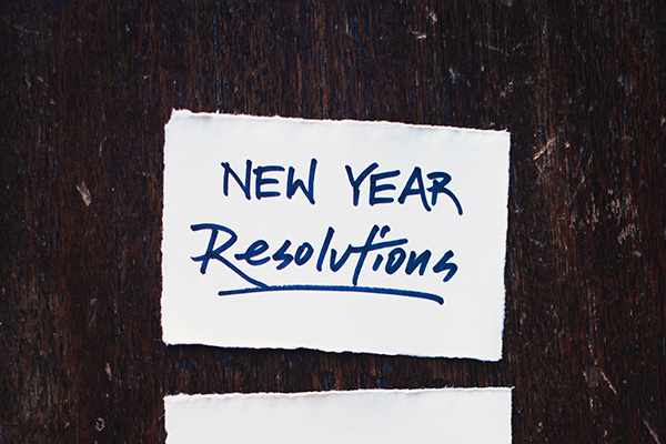 New Year Resolutions written on piece of paper